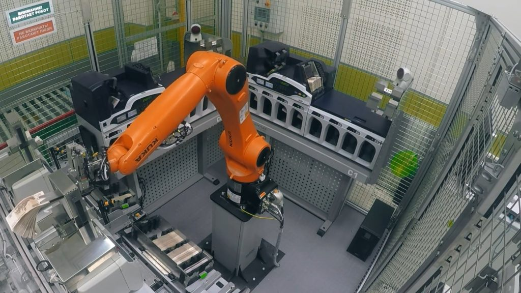 Industrial robot is counting money in bank